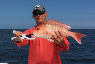Captain Jared holding a red snapper