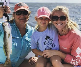 Happy girls fishing in Apalachicola