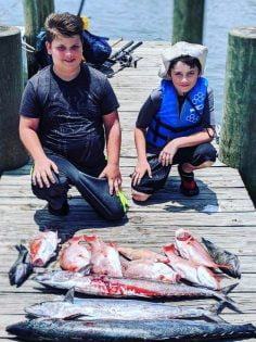 Young boys with the fish caught on the charter